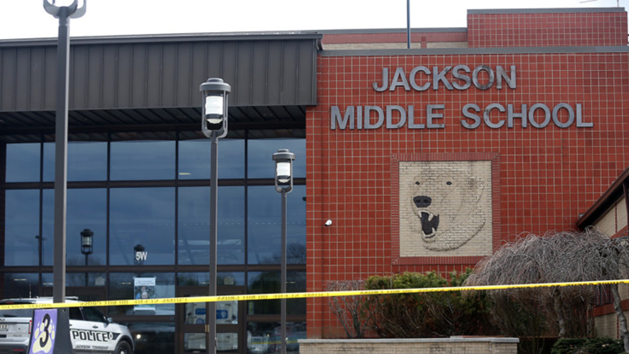 Jackson Middle School was taped off on Feb. 20. Jackson schools were put on lockdown and evacuated after a middle school student brought a gun to school and shot himself in the bathroom. (Leah Klafczynski/Beacon Journal/Ohio.com)